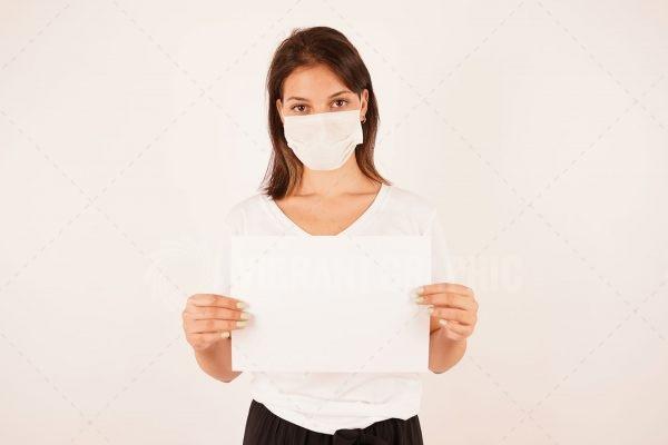Holding a sign for a corona virus concept