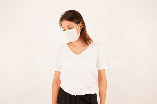 Sad woman wearing protective mask